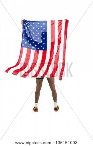 Athlete posing with american flag after victory on white background