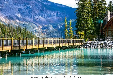 Wooden bridge over Emerald Lake. Camping and coniferous forest. Yoho National Park, Canada