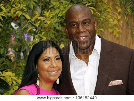 Earlitha Kelly and Magic Johnson at the Los Angeles premiere of 'The Legend Of Tarzan' held at the Dolby Theatre in Hollywood, USA on June 27, 2016.