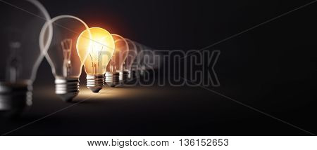 Glowing light bulb on dark background - 3D Rendering