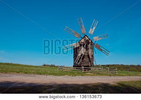 Landscape with old windmill next to the road in the village Pirogovo. Ukraine. Eastern Europe.