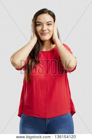 Lovey woman covering her ears with hands