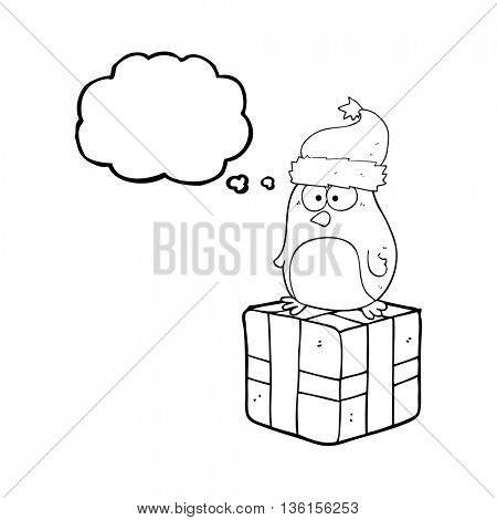 freehand drawn thought bubble cartoon robin on present