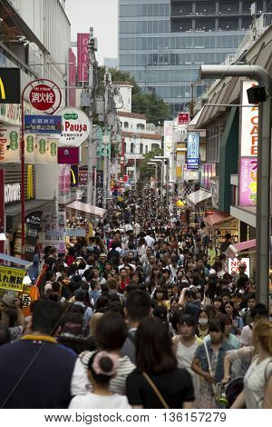 TOKYO-JAPAN, 18 June 2016: people shopping street lined with fashion boutiques, cafes and restaurants on takeshita dori in Harajuku in Tokyo