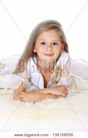 beautiful little girl lying on tummy and smiling on white background isolated