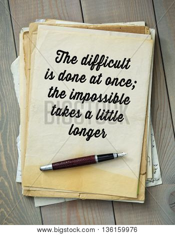 Traditional English proverb. The difficult is done at once; the impossible takes a little longer