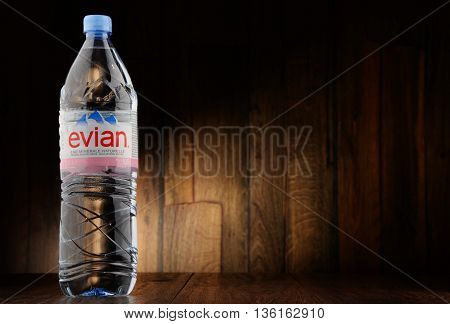 POZNAN POLAND - JUNE 24 2016: Evian is a brand of mineral water made in France on the south shore of Lake Geneva owned by multinational corporation Danone