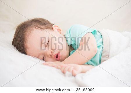 Newborn cute baby sleeping. Closeup portrait caucasian child