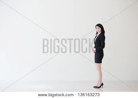 business woman stand with white wall background great for your design or text asian