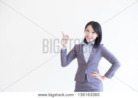 business woman stand and show something with white wall background great for your design or text asian