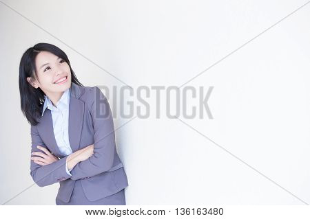 business woman look something with white wall background great for your design or text asian