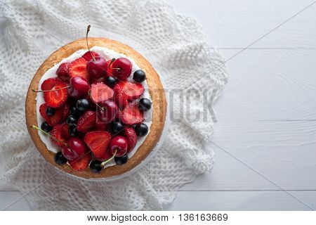 Traditional strawberry cake homemade gourmet sweet dessert bakery food decorated with berries and whipped cream on white background table