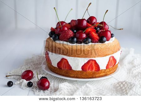 Tasty fresh strawberry cake homemade traditional gourmet sweet dessert bakery food decorated with berries and whipped cream on white background table