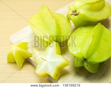 Starfruit And Starfruit Slice On A Wood Background