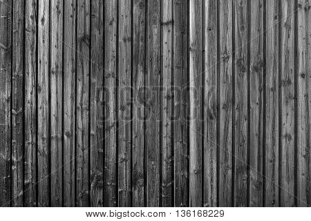 Detail of a dark wooden wall of vertical boards