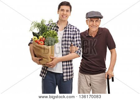 Young man holding bag of groceries and posing with his grandpa isolated on white background