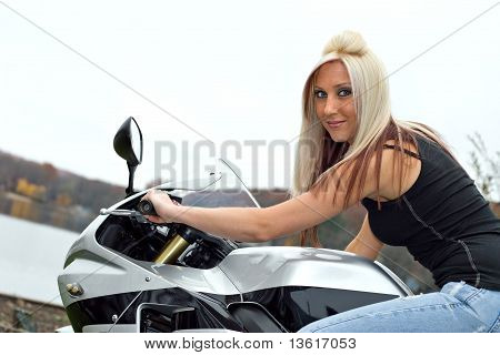 Woman Seated On A Motorcycle