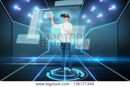 3d technology, virtual reality, cyberspace, programming and people concept - happy young man in virtual reality headset or 3d glasses working with coding on screen over dark background and laser light