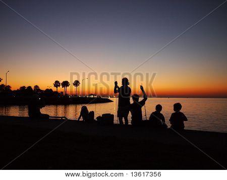 fishing in sunset of lake