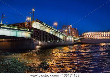Night View Of Illuminated Foundry Bridge.