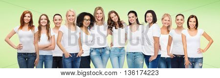 friendship, diversity, body positive and people concept - group of happy women of different age size and ethnicity in white t-shirts hugging over green natural background