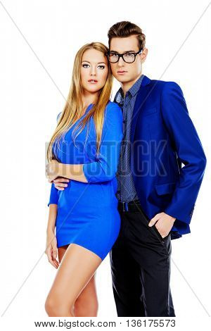 Portrait of young fashionable couple over white background. Isolated.