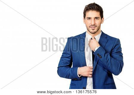 Fashion shot of a handsome man wearing elegant suit. Men's beauty, fashion. Isolated over white.