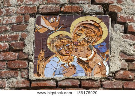 Mosaic above the entrance to burned XVII century church of St. Michael the Archangel in Stara Sil - Western Ukraine
