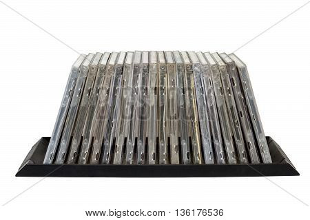 Isolated front view of stacked old grungy compact disk holders on white