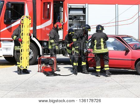 Firefighter Open Car Door With Pneumatic Shears After The Traffic Accident