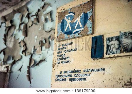 Pripyat, Ukraine - May 29, 2016: wall poster in abandoned school in Pripyat, Chernobyl, Ukraine