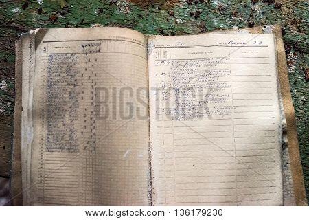 Pripyat, Ukraine - May 29, 2016: opened class journal on table with peeling paint in Pripyat school, Chernobyl, Ukraine