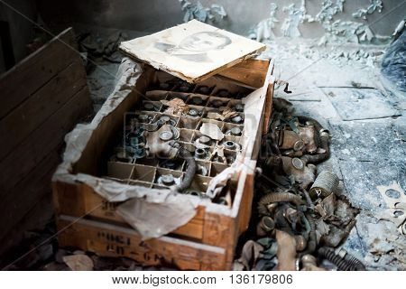Pripyat, Ukraine - May 29, 2016: abandoned school room with masks in box on the floor in Pripyat, Chernobyl, Ukraine