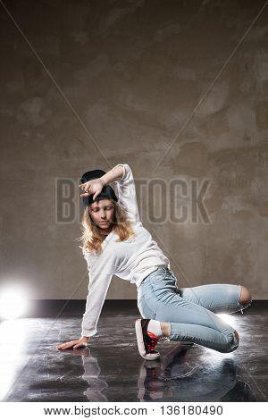 Portrait of young woman performing street dance.Studio shot