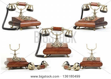Vintage telephone of wood. Phone on a white background.