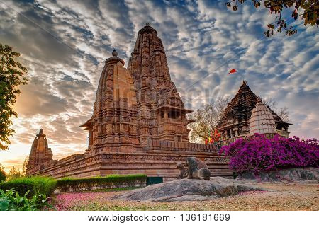 Beautiful image of Eastern Temples of Khajuraho Madhyapradesh India with blue sky and fluffy clouds in the background It is worldwide famous ancient temples in India UNESCO world heritage site.