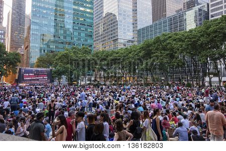 MANHATTAN NEW YORK CITY - June 20 2016 - Crowds gather at Bryant Park for the Summer Film Festival