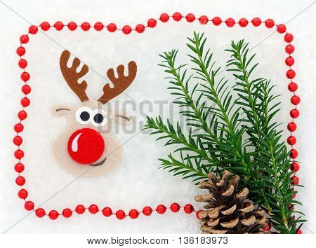 Christmas card red and white, reindeer, christmastree, pine cone, garland in snow background