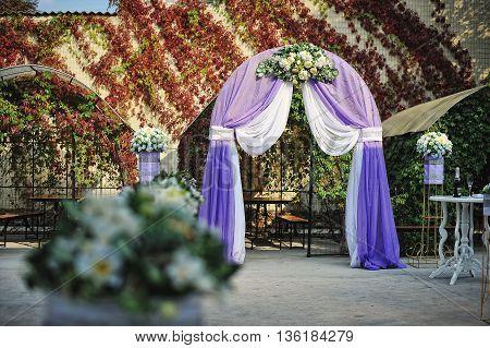 Purple White Wedding Arch Otdoor Background Leaves Wall