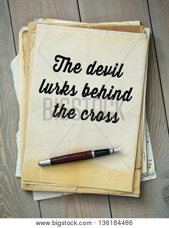 Traditional English proverb.  The devil lurks behind the cross