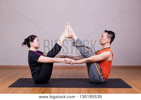 Partner Buddy Boat Yoga Pose By A Couple
