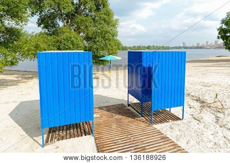 Blue metal wear changing cabins near on the sand beach near to the Dnieper river in Kiev