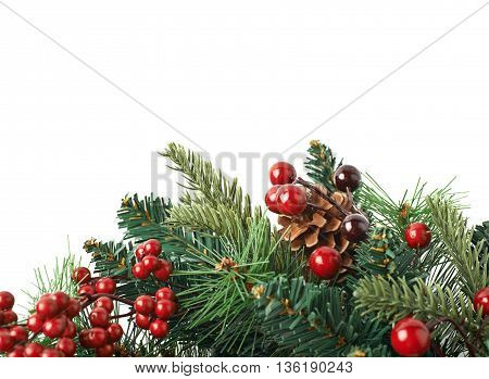 Close-up fragment of a fir Christmas wreath isolated over the white background as a copyspace backdrop composition