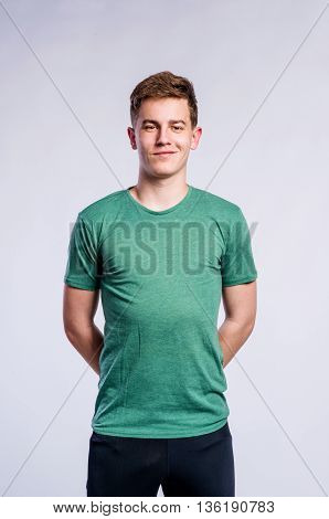 Boy In Black Sports Trousers And T-shirt, Studio Shot