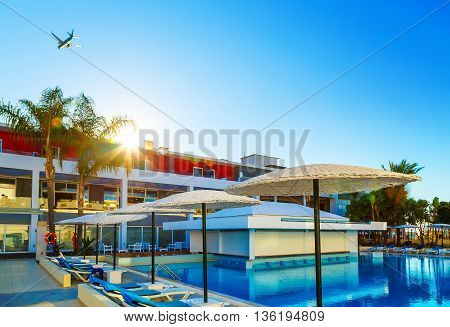 modern European resort. the sun. flying the aircraft. pool with bar