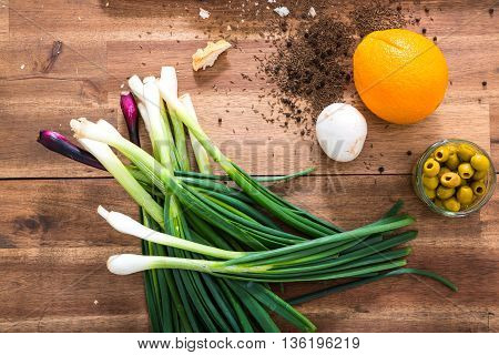 Organic ingredients on a wooden Table in the Kitchen.
