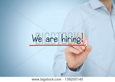 Headhunter (recruiter) write and underline text we are hiring - human resources concept..