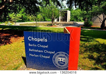 Waltham Massachusetts - July 12 2015: Three chapels sign at Brandeis University with the Berlin Jewish chapel in the background