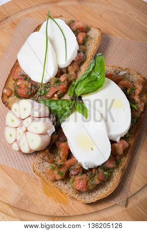 Italian bread with mozzarella cheeze on wooden board
