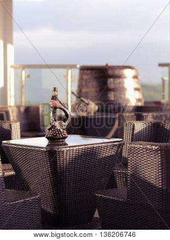 a table with a bottle of wine in the summer restaurant